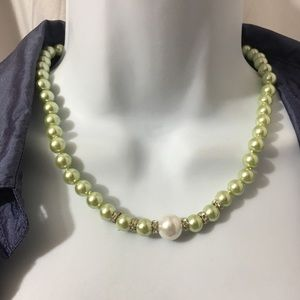 #102b-  Seashell green pearl necklace.